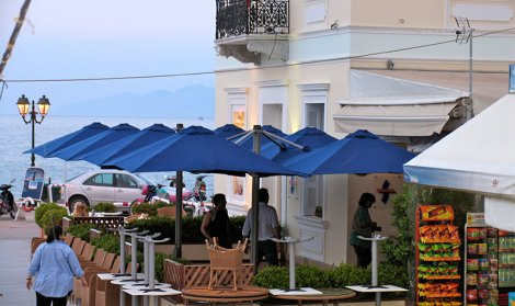 covered seating area with blue umbrellas