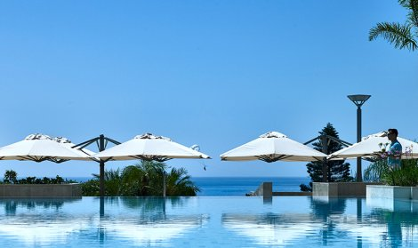infinity pool with hotel umbrellas