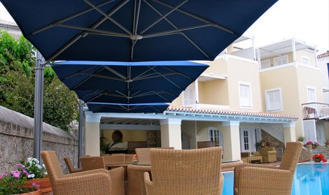 blue parasols canopy covering outdoor living area
