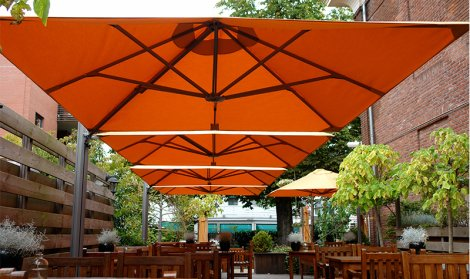 All weather outdoor seating space with giant orange parasols