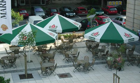 green and white outdoor seating covers