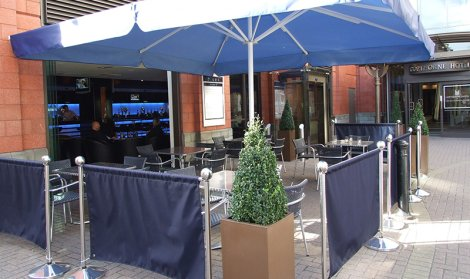 blue restaurant canopy covering table and chairs