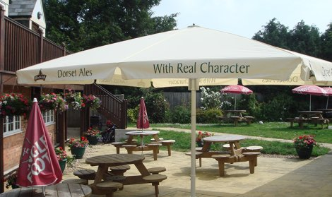pubs outside space covered with giant white umbrella