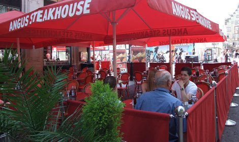 red cafe canopy covers outdoor seating area